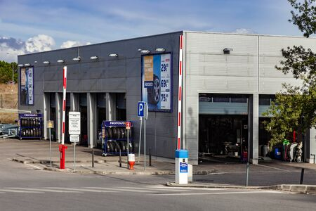 Coina, Portugal - October 23, 2019: Norauto car or auto service station and parts shop. Auto repair shop in Barreiro Planet Retail Park. Norauto is a French company Editoriali