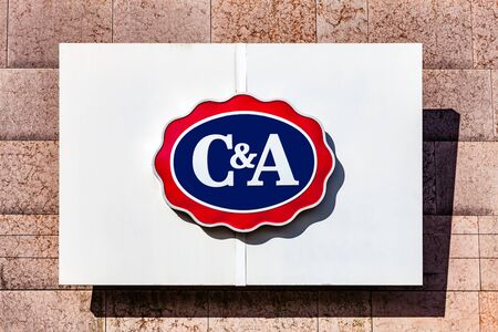 Almada, Portugal - October 24, 2019: Signboard advertising the C&A clothing store in a shopping center or shopping mall exterior wall. Editoriali