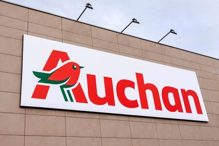 Coina, Portugal - October 23, 2019: Auchan logo or symbol in the Barreiro Planet Retail Park. Auchan is a French hypermarket, supermarket or superstore chain