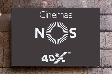 Almada, Portugal - October 24, 2019: Signboard advertising a NOS Cinema with 4DX in a shopping center or shopping mall exterior wall.