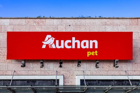 Almada, Portugal - October 24, 2019: Auchan Pet store or shop logo or symbol in the Almada Forum shopping mall or center. Auchan is a French hypermarket, supermarket or superstore chain