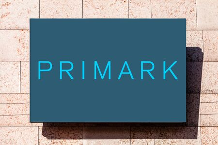 Almada, Portugal - October 24, 2019: Signboard advertising the Primark clothing store in a shopping center or shopping mall exterior wall.