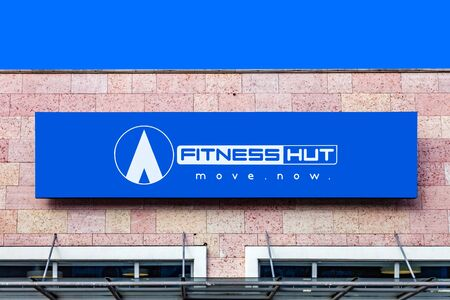 Almada, Portugal - October 24, 2019: Fitness Hut store, shop logo or symbol in the Almada Forum shopping mall or center. Fitness Hut is workout gym focused on premium services at low cost