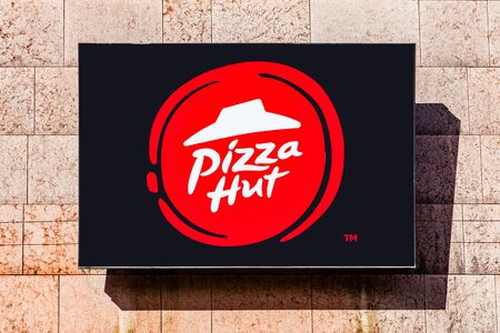 Almada, Portugal - October 24, 2019: Signboard advertising Pizza Hut restaurant in a shopping center or shopping mall exterior wall