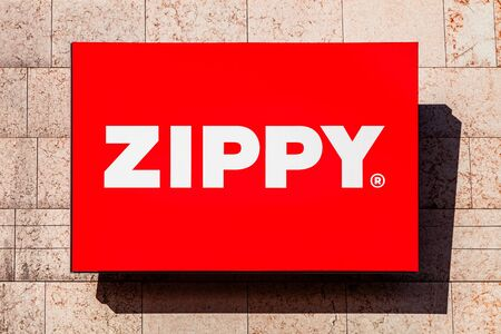 Almada, Portugal - October 24, 2019: Signboard advertising the Zippy store in a shopping center or shopping mall exterior wall. Zippy is a children and baby clothing chain store from SONAE corporation Editoriali