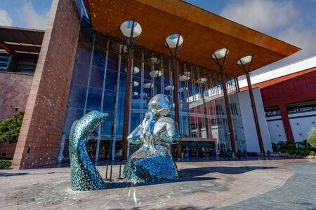 Almada, Portugal - October 24, 2019: Main entrance of the Almada Forum shopping center or mall with the broken glass mermaid sculpture. One of the largest shopping malls in Portugal close to Lisbon. Editoriali