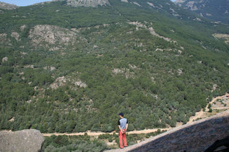 Climber looking at La Pedriza from above