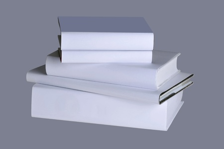 Five white books isolated on a gray photo