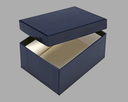 Small blue box, open with a lid, for design layout