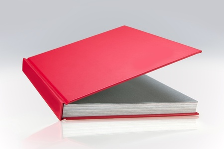 Red book, open, with plain hard cover, for design layout