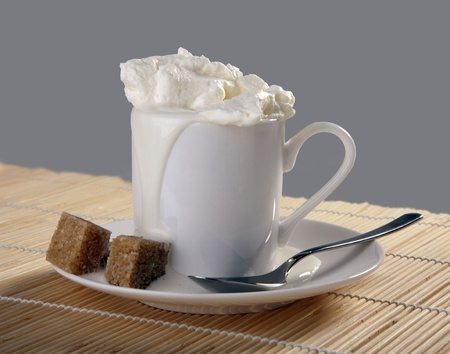 Cup with coffee and whipping cream Stock fotó
