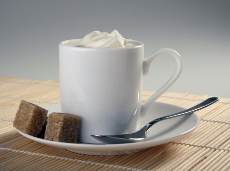 Cup of coffee with whipping cream