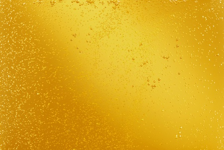 Gold beer in a glass texture
