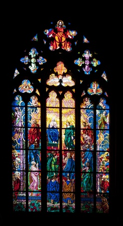 Stained glass window in St. Vitus Cathedral at Hradcany in Prague