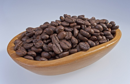 Coffee beans roasted, in wooden bowl