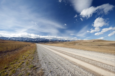 rocky road: Gravel road to Canadian Rockies in Alberta, Canada Stock Photo