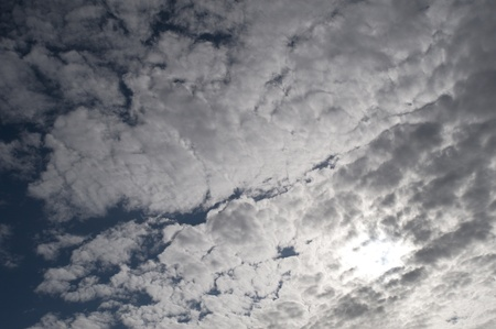 Blue sky with white scattered clouds Stock Photo