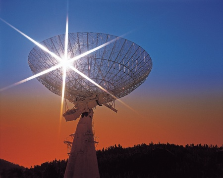 Radio telescope with the sun illumination photo
