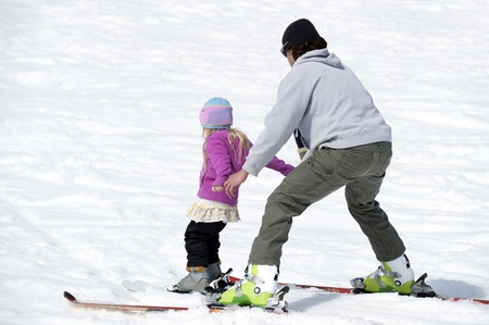 Father and daughter skiing