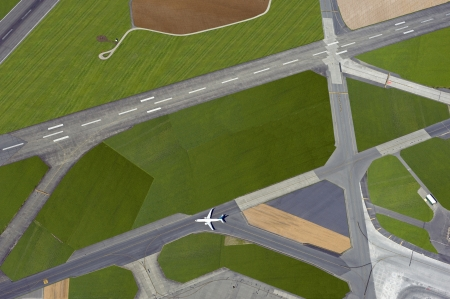Airport with the runways and one aircraft