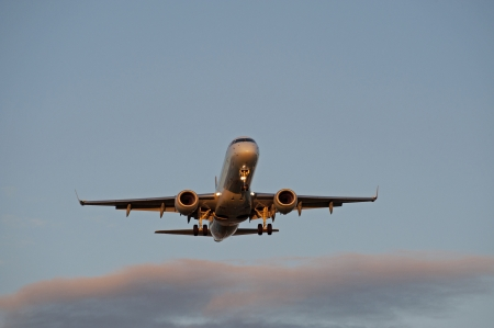 Two jet engine aircraft before landing photo