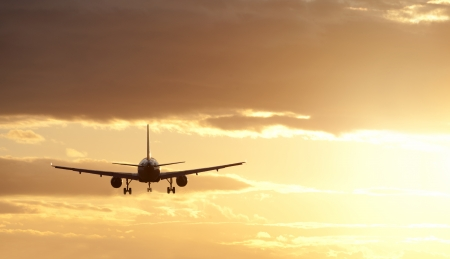 airplane take off: Two jet engine aircraft in sunset Stock Photo