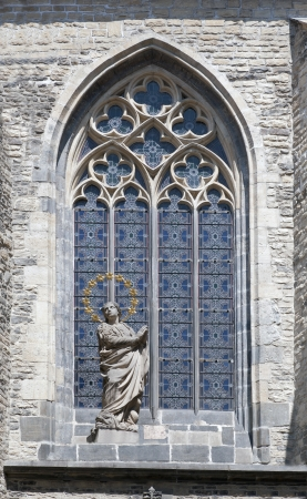 Prague - Gothic glass stained window with the angel 스톡 콘텐츠
