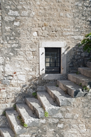 Historic stone stairs and window photo
