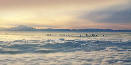 mt baker: Vancouver, Richmond and Mt  Baker in the clouds Stock Photo