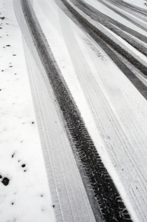 Winter tire marks in the snow Stock Photo - 17548367
