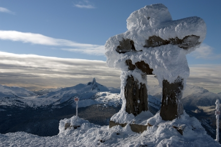Whistler peak with the Ilanaaq the Inukshuk Logo Stock Photo - 17680643