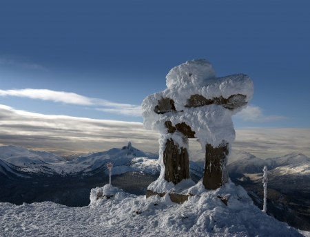Whistler peak with the Ilanaaq the Inukshuk Logo Stock Photo - 17680642