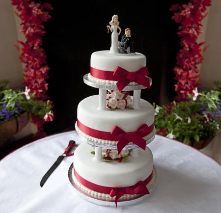 Wedding Cake - three storey cake with figures photo