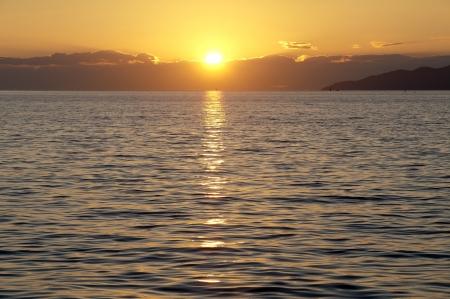Sunset above the sea photo