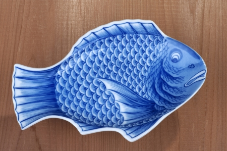 blue fish: Blue plate, dish as a fish Stock Photo