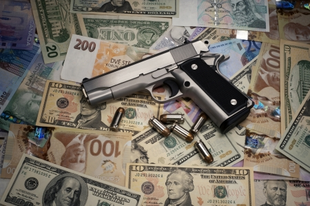 Gun and money photo