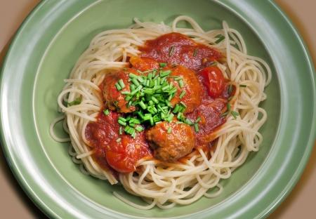 Spaghetti - spaghetti Bolognese with meatballs and green chive Banco de Imagens