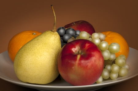 Fruit - still life with apple, orange, vine and pear