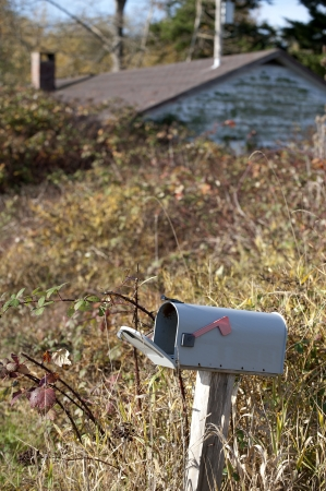old envelope: Mail box - country letter box with old abandoned house
