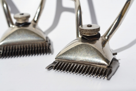 Pair of old hair clippers on white background. Stock Photo