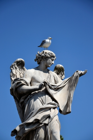 Angel with the Sudarium on the Sant Angelo bridge in Rome. Stock Photo - 15250515