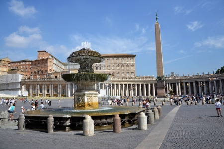 ROME, ITALY - JULY 11  Tourist in front of Saint Peter s Basilica at Saint Peter s Square on 11 July 2012 in Vatican, Rome, Italy  Stock Photo - 15319034