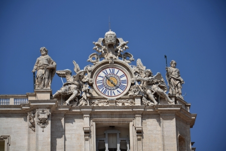 st  peter s square: Clock on the roof of Basilica of Saint Peter in Vatican