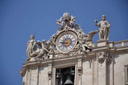 Clock on the roof of Basilica of Saint Peter in Vatican Stock Photo - 15545601