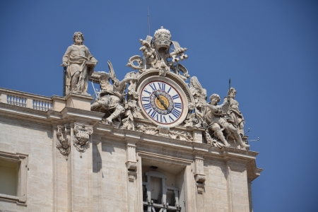 Clock on the roof of Basilica of Saint Peter in Vatican Stock Photo - 15545602