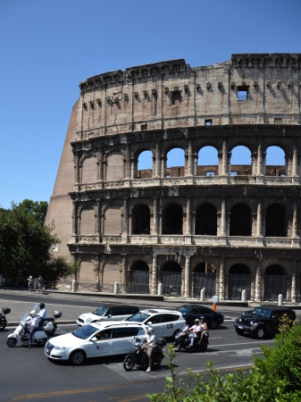 Rome, Italy - July 10, 2012 – Cars in front of Colosseum in Rome. Experts say ancient building has started to tilt and may need urgent repairs. Stock Photo - 15547646