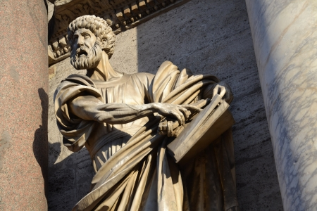 Statue of Saint Peter by Francesco Mochi on Porta del Popolo, Rome, Italy  photo
