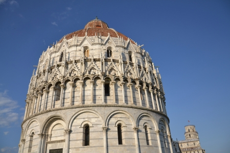 The Baptistery and the Leaning tower of Pisa, Italy. photo
