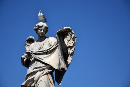 Angel with the Sudarium on the Sant Angelo bridge in Rome. Stock Photo