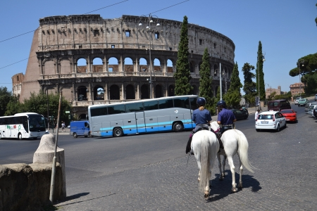Rome, Italy - July 10, 2012  Police patrol on horses in front of Colosseum in Rome  Police patrol on horses crosses the street in front of Colosseum in Rome, Italy  Stock Photo - 15838960